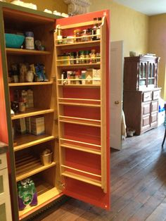 kitchen larder cupboard, showing the inside with oak shelves and spice rack