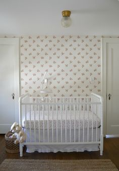 Shabby Chic Nursery featuring a vintage-inspired floral wallpaper accent wall