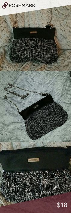 Miche Purse/Clutch with Removable Chain Strap Miche bag. Never worn still have bag it came in. Small black and white tweed fabric purse with detachable silver chain strap. Can be worn as a purse or clutch. Simple & cute. Interior has three credit card slots and zipped pocket. Zipper closure. Miche Bags