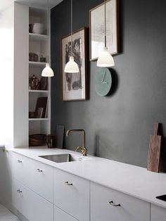 Minimalistic kitchen with concrete colour wall