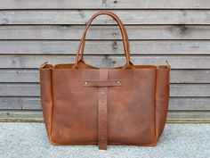 Leather bag in cognac,(medium size)with leather shoulderstrap COLLECTION UNISEX