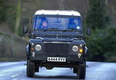Queen Elizabeth II, in a Land Rover Defender 110 variant, as she drives herself to Balmoral