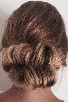 Fishtail braided bun updo by @rjchairdesign! Love this effortless look!   Photo by: https://www.instagram.com/rjchairdesign/