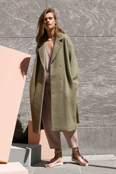 Oversized coat and soft colors.