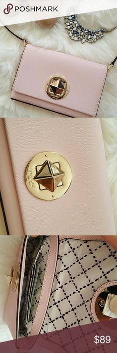 """KATE SPADE Sally Newbury Lane crossbody BNWT with care booklet.  Darling pink! Not quite bubble gum pink, but deeper than pale.  14K Gold hardware.  Price FIRM on this one because I'm trying to recoup what I spent ($69.99+sales tax which is on the sticker attached to the tag). Consider Posh fees, hence price listed. Thank you!  7.5""""x5x1"""" Strap drops to 22"""" maximum.   ** price firm - bundle for a discount!  ** kate spade Bags Crossbody Bags"""
