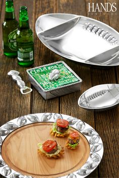 Mariposa's line of football pieces are sure to class up your tailgate this year!  Available now at Hands