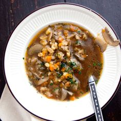 Mushroom-Barley Soup - a hearty beef stock serves as the base for a rich soup of mushrooms and barley, a more elegant (but no less satisfying) version of the New York deli staple, elevated with fresh thyme and a squeeze of lemon juice