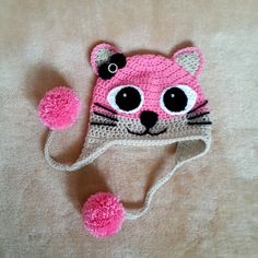 Adorable Crocheted Kitty Hat With Ear Flap and pompoms!  These hats would be a great gift for someone you love! This hat can be custom made in