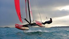 This gravity-defying US$40k catamaran rises completely out of the water at speed on a pair of hook-shaped hydrofoils. It looks like the work of David Copperfield, but it's real, and it's set to start a revolution in the sailing world.