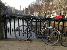 Bike on a bridge overlooking an Amsterdam canal. Thalys Train, Amsterdam Canals, Train Journey, Cologne, Bridge, Bridges, Attic, Bro