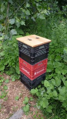 Make your own composter. Instructables. - easy. http://www.instructables.com/id/Milkcrate-Composter-vertically-stacked/