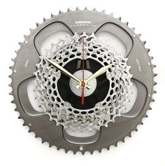 Bike Gear Clock -  Handcrafted from the finest recycled SRAM Bike Parts, in the Tread & Pedals Upcycling Studio, to give a sleek industrial design. We love the contrast of the polished metals with the red second hand, with this Bike Clock you can quite literally count the seconds until your next ride.