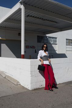 LA Blogger Tania Sarin wearing Saloni red ruffle pant styled with Tibi plaid corset and Mark Cross bag.