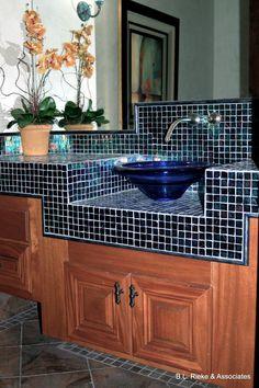 The glass mosaic-tiled countertop and glass sink make this bathroom a customer favorite! (Home Design & Decor by B.L. Rieke & Associates, Inc.) Visit us at http://blrieke.com