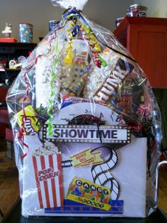 Everyone loves the movies… and where there's a movie, there's popcorn! What better gift to give than a movie night basket? It's a perfect gift for a family or your favorite college student! Movie night parties are simple and fun. Pick a category of your favorite shows and they are all set for an evening of entertainment!
