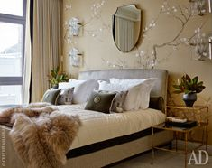 Sheila shaped mirror, chinoiserie wallpaper & glass sconces