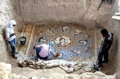 Workers clear a mosaic depicting the nine Muses | Archaeologists Unearth Three Ancient Greek Mosaics in the Ongoing Excavation in Zeugma, Turkey - laughingsquid.com