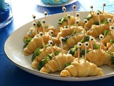 these would be so easy to do...whip up some  stuffed crescent roll sandwiches, or mini croissant sandwiches and stick in eye ball skewers...must make a batch of eye balls on toothpicks for future use!