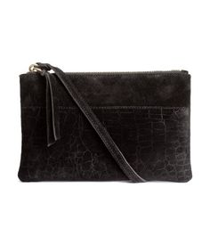 Suede Shoulder Bag $39.99  PREMIUM QUALITY. Shoulder bag in suede with a crocodile pattern at front. Narrow shoulder strap that fastens on one side, zip at top, and one inner compartment. Lined. Size 5 3/4 x 9 in.