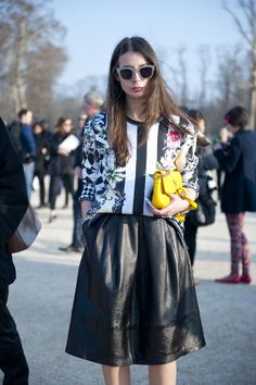 A leather A-line skirt   is the perfect match for a monochrome floral printed blouse.