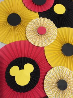 Set of 26 Mickey Mouse Paper Rosettes These beautiful Mickey Mouse Rosettes are created from a heavy quality card stock paper. Rosettes are shipped fully assembled. This Set of 26 Rosettes Include: 6- Large 11.5 Rosettes 10- Medium 8 Rosettes 10- Small 5-6 Rosettes *** OTHER