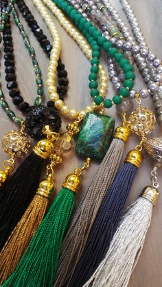 Long beaded necklace. Green tassel by AllAboutEveCreations on Etsy