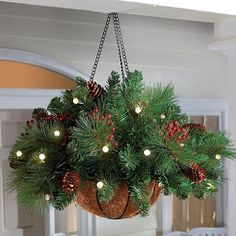 Porch Decoration for Christmas - hanging baskets and add a few springs of garland, some battery operated lights, some pine cones and holly. Noel Christmas, All Things Christmas, Winter Christmas, Christmas Lights, Christmas Wreaths, Christmas Ornament, Christmas Greenery, Winter Porch, Office Christmas