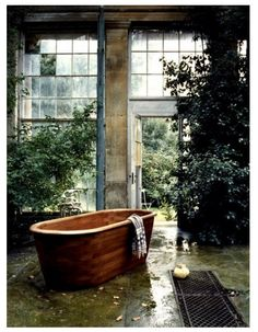this is the way to a bath...in a conservatory