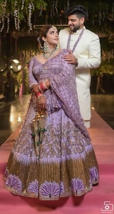Bridegroom, choose a beautiful emerald outfit combination where the bride wears an all green printed lehenga, and the groom wears an off-white sherwani with emerald green dupatta. Indian Bridal Outfits, Indian Dresses, Choli Dress, Sari Blouse, Bridal Lehenga Collection, Lehenga Designs, Party Wear Dresses, Bridal Dresses, Groom Outfit