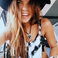 hipster beach wear, nose ring, hat, beach waves -- perfection