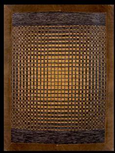 Ventas Online:  Online Sales: www.gogoanhalzer.com http://www.gogoanhalzer.com/en/products-page/rugs/danero/  DAMERO (RUG) This hand woven rug in arpillera with leather borders (10 cm.) was inspired by Pre-Colombian stamps. Made by Gogó Anhalzer.  DAMERO (ALFOMBRA) Bordado a mano en lana natural sobre arpillera, enmarcada con cuero (10 cm.). Realizado bajo la inspiración de sellos precolombinos por Gogó Anhalzer.