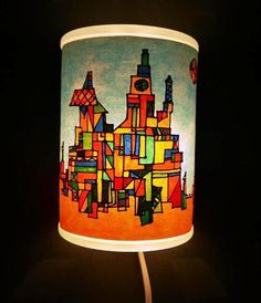 City of Light Lamp: Mixed media. Inspired by the paintings created by the artist Paul Klee, teens will enjoy creating a glowing cityscape for their lamp.