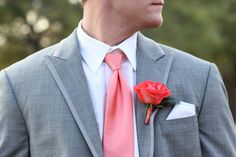 Coral boutonniere // photo by Wings of Glory Photography