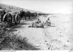 PALESTINE, C. 1918. A HALT FOR THE 3RD AUSTRALIAN LIGHT HORSE IN THE DESERT IN PALESTINE. NOTE THE WIDE SAND TYRES ON THE WAGONS. (DONOR: A. WADDELL).