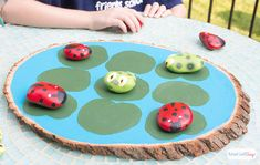 Paint your own ladybugs vs. tadpoles tic tac toe game. Tutorial at AttaGirlSays.com