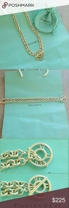 """Tiffany Atlas Necklace Tiffany & Co Atlas Toggle Necklace in silver. In perfect condition, no longer available in stores. Chain is 17"""" long and Atlas pendant is 1"""" across. Authentic, purchased at Tiffany downtown Seattle. Comes with pouch. No trades. Tiffany & Co. Jewelry Necklaces"""