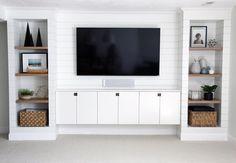 Built-ins and shiplap done right. #fixerupper #style #trending #white #shiplap #shelves #cabinets #tv #room #roomdecor : @chrislovesjulia