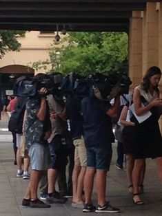 Media camera operators waiting outside the Sir Samuel Way Building Victoria Square Adelaide 2018