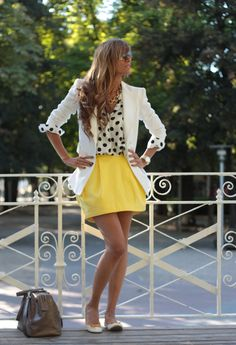 Loving that blazers are on the trend!  Loving this white blazer paired with a polka dot top and yellow skirt!