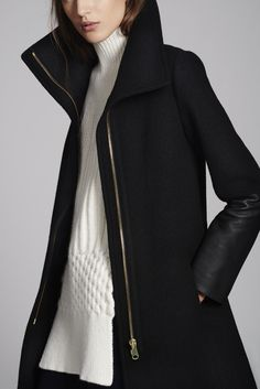 """clubmonaco: """" Speak volumes in a leather-trimmed coat with enveloping collar. """""""