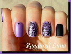 Stamping: Black flowers skittlette manicure on light purple