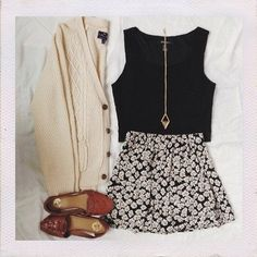 floral skirt, black shirt, and neutral accessories