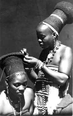Africa | Young Zulu woman having her hair done.  South Africa.  ca. early to mid 20th century || Scanned photographic postcard