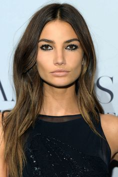 Who: Lily Aldridge What: Inky Black Eyeliner How-To: Adridge's glossy, black eyeliner is the perfect example of how to transition your makeup from day to night. Prep your lids with eye shadow primer so that the color doesn't migrate, then use an eyeliner brush to rim your upper and lower lash lines with waterproof liner—a gel formula will give that slick, just-out-of-the-water (in a good way) finish. Pair with nude lips and subtle bronzer for a simple, sexy look. Editor's Pick: NARS Eye ...