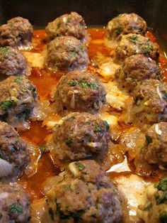 Smoked Mozzarella Stuffed Meatballs Recipe!  Ingredients 1 small onion, grated 1/2 cup fresh flat-leaf parsley, chopped 2/3 cup grated Parmesan Cheese 1/3 cup Italian bread crumbs 1 large egg 2 tablespoons marinara sauce (I use Victoria's) plus 1/3 cup 3 garlic cloves, minced 1 pinch of crushed red pepper flakes Salt and pepper to taste 1 package of ground beef (1.5-2lbs) 16 cubed pieces of smoked mozzarella cheese (1/2 inch cubes) Position the oven rack in the lower 1/3 of the oven. ...