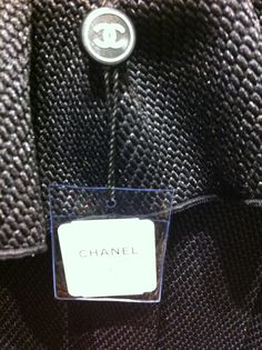 Swing Tag Research. Logo tag holder, Clear pouch could be used to store spare buttons etc.
