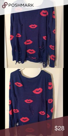 Shirt Used: This is a long-sleeve dark blue ripped sweater with pink kisses all over. Can be worn with your favorite jeans and booties. This is a snug sweater, nice for cold weather and can be worn with a light jacket. Sweaters Crew & Scoop Necks
