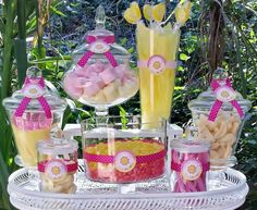 Candy jars at a sunshine birthday party!  See more party planning ideas at CatchMyParty.com!