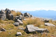 Rocks on the top of a mountain in the Nelson Lakes National Park and in the background a wonderful view.