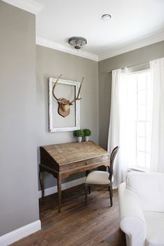 I love the color palette & the wood floor stain. The color of the wood floors feels warm & classic.